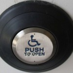 Large and clearly labelled push to exit button inside office door